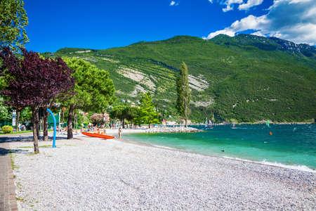 pebble beach in the small village Torbole on the Garda lake, Trentino, Italy