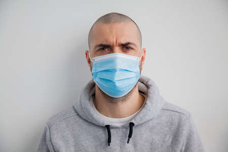 Man wearing hygienic protective mask to prevent infection such as coronavirus 2019-nCoV Zdjęcie Seryjne