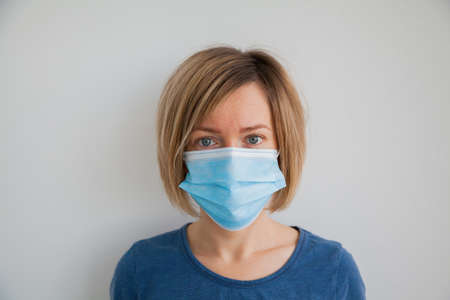 Woman wearing hygienic protective mask to prevent infection such as coronavirus 2019-nCoV Zdjęcie Seryjne
