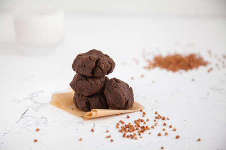Homemade buckwheat flour healthy cookies with a glass of milk. Gluten-free baking.