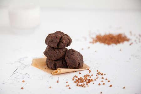 Homemade buckwheat flour healthy cookies with a glass of milk. Gluten-free baking.