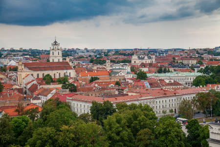 Beautiful view of the Old town in Vilnius with small houses, churches and red tiles
