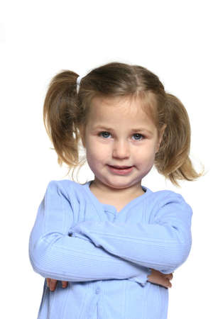 Cute, smiling little girl with pig tails and arms crossed isolated on white Stock Photo - 3596346