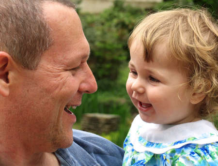 Baby and Daddy laughing and having fun together Stock Photo