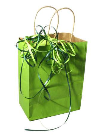 Green shopping bag over white