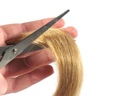 Scissors cutting a lock of blonde hair