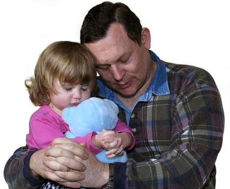 hombre orando: Padre ense�anza ni�a a orar