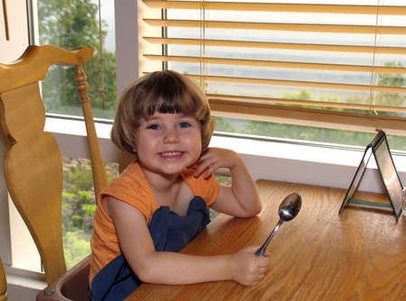 Child getting ready for dinner out at a restaurant