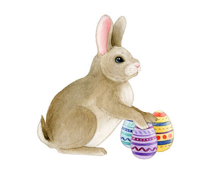 Funny Easter bunny with painted eggs watercolor image. Festive traditional animal hand drawn image. Sweet rabbit standing with colorful gifts. Isolated on white background.