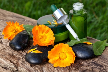 skin care, cream, serum with orange marigold flowers