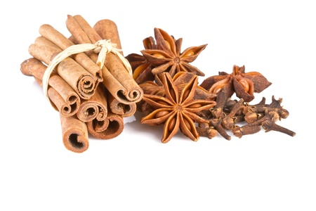 cinammon: anise, cinammon and carnation isolated on white background