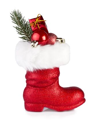weihnachtsmann: santa claus boots with gifts isolated on white