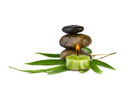 zen pebbles with bamboo leaves and candle, isolated Stock Photo - 16573309