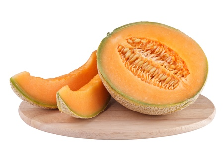 sliced piece cantaloupe melon on wooden carving board