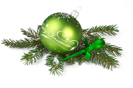 green christmas ball with fir branch on white backgound