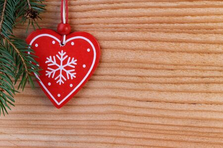 red heart on wooden background, christmas decoration photo