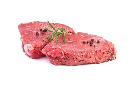 raw beef steak with green herbs