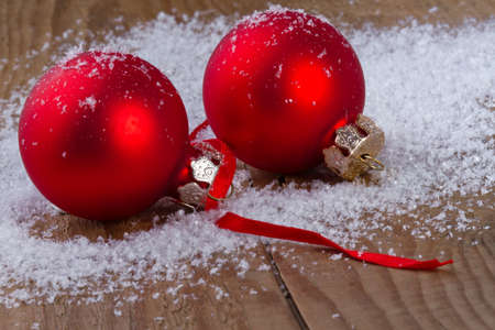 Christmas red balls on wooden background