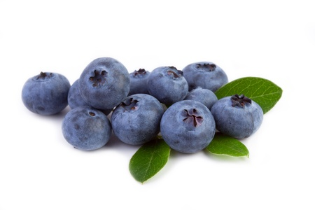 fresh blueberry with leaves isolated on white