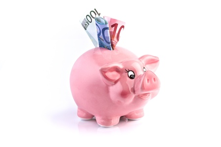 pink piggy bank with euro money photo