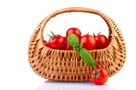 fresh tomatoes in basket isolated on white background Stock Photo - 17337092