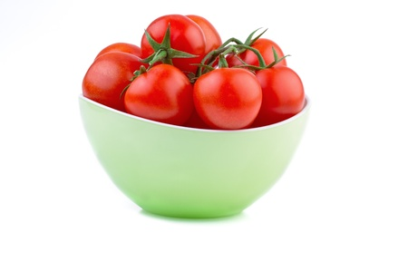 fresh tomato in green bowl isolated  on white Stock Photo - 17337088