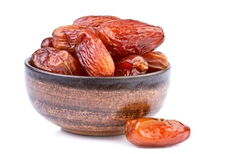 dried dates in brown cup isolated on white