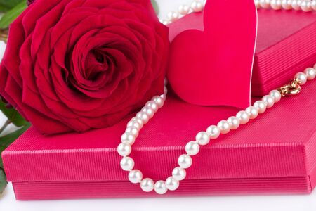 gift box with red rose and heart and pearl necklace