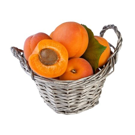 apricots in basket isolated on white background, square photo