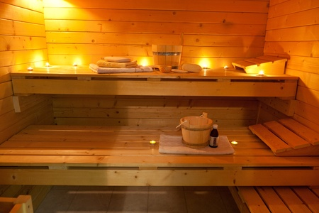 interior of a finnish sauna in candle light photo