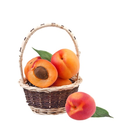 fresh apricot in wicker basket isolated on white Stock Photo - 20400856