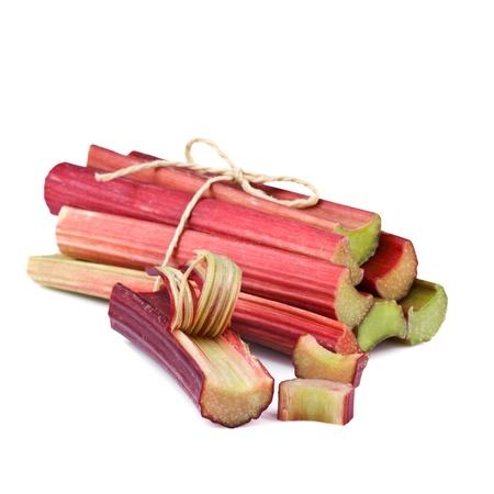 bundle of rhubarb stalks on white background