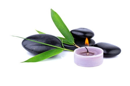 bamboo leaf and zen pebbles, candle over white, spa  concept photo