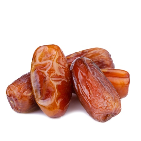 dried dates on white background