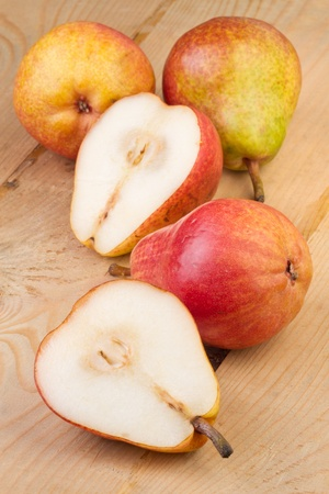 Ripe Pears on wooden background