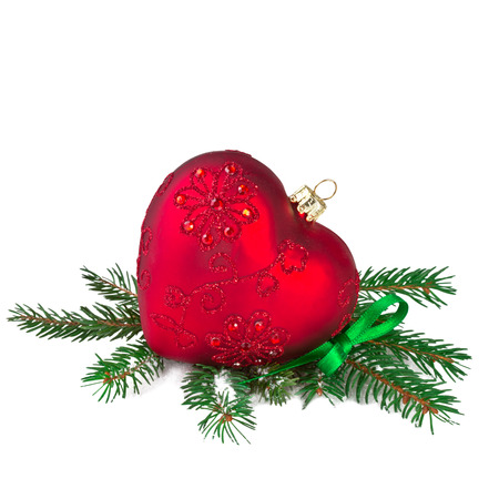 text free space: Christmas Red Heart with Fir Branch Stock Photo