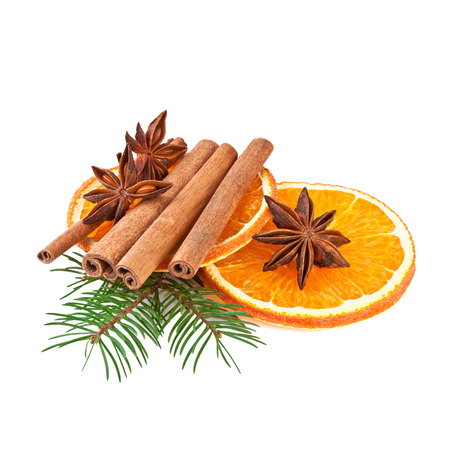 Orange Slices and Cinnamon with Fir branch isolated on White photo