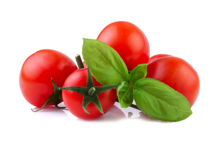 Cherry Tomatoes with Basil leaf isolated on white photo