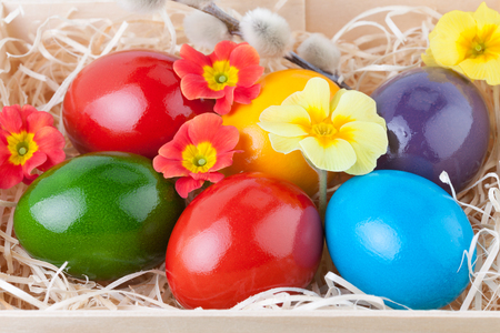 Colorful Easter Eggs in a Wooden Box in Closeup photo