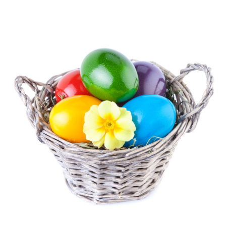 Easter Eggs in a Basket Isolated on White photo