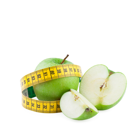measuring tape: Healthy eating and diet concept. Green apples and measuring tape isolated on  white background