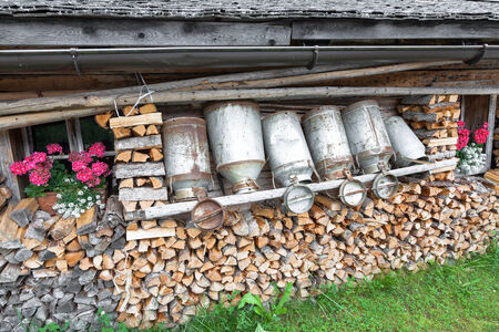 milk cans: old milk cans and firewood in a alpine hut