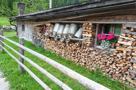 old milk cans in a alpine hut photo