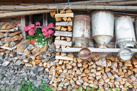 decorative old milk cans of a mountain hut photo