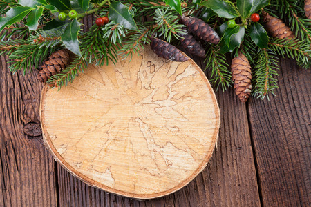 Vintage Wooden Background with Pine Branch and Tree Ring photo
