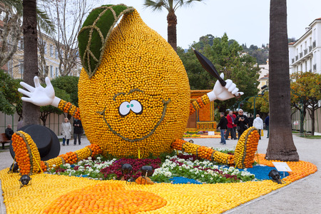 musketeer: MENTON, FRANCE - FEBRUARY 27: Lemon Festival (Fete du Citron) on the French Riviera.The theme for 2013 was \Around the World in 80 Days: Menton, the Secret Stop\. Thousands of lemons and oranges are used to build huge citrus constructions. Menton, F