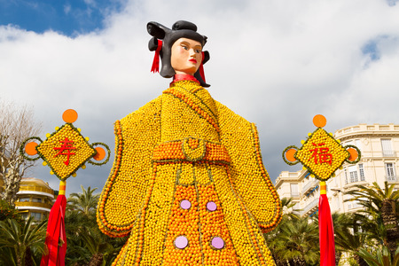 tonnes: MENTON; FRANCE - FEBRUARY 20: Lemon Festival (Fete du Citron) on the French Riviera.The theme for 2015:Tribulations of a lemon in China. Over 140 tonnes of lemons and oranges are used to build huge citrus constructions. Menton; France - Feb 20; 2015