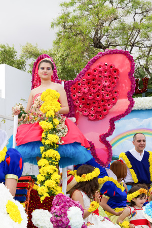 flower parade: FUNCHAL, MADEIRA - APRIL 20, 2015: Participants in a Floral Float at the Madeira Flower Parade, Funchal, Madeira, Portugal Editorial