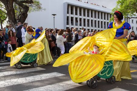 prams: FUNCHAL, MADEIRA - APRIL 20, 2015: Mothers with babies in prams at the Madeira Flower Festival, Funchal, Madeira, Portugal