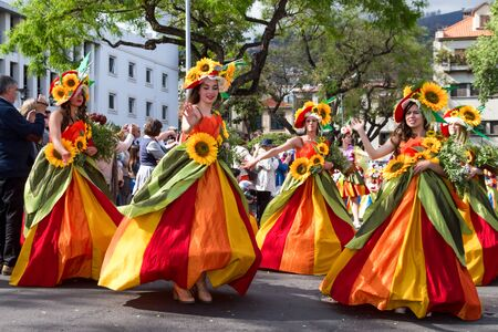 flower parade: FUNCHAL, MADEIRA - APRIL 20, 2015: Dancers perform during of Flower parade at the Madeira Island, Portugal